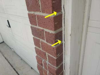 Photo of door caulking separation of a home